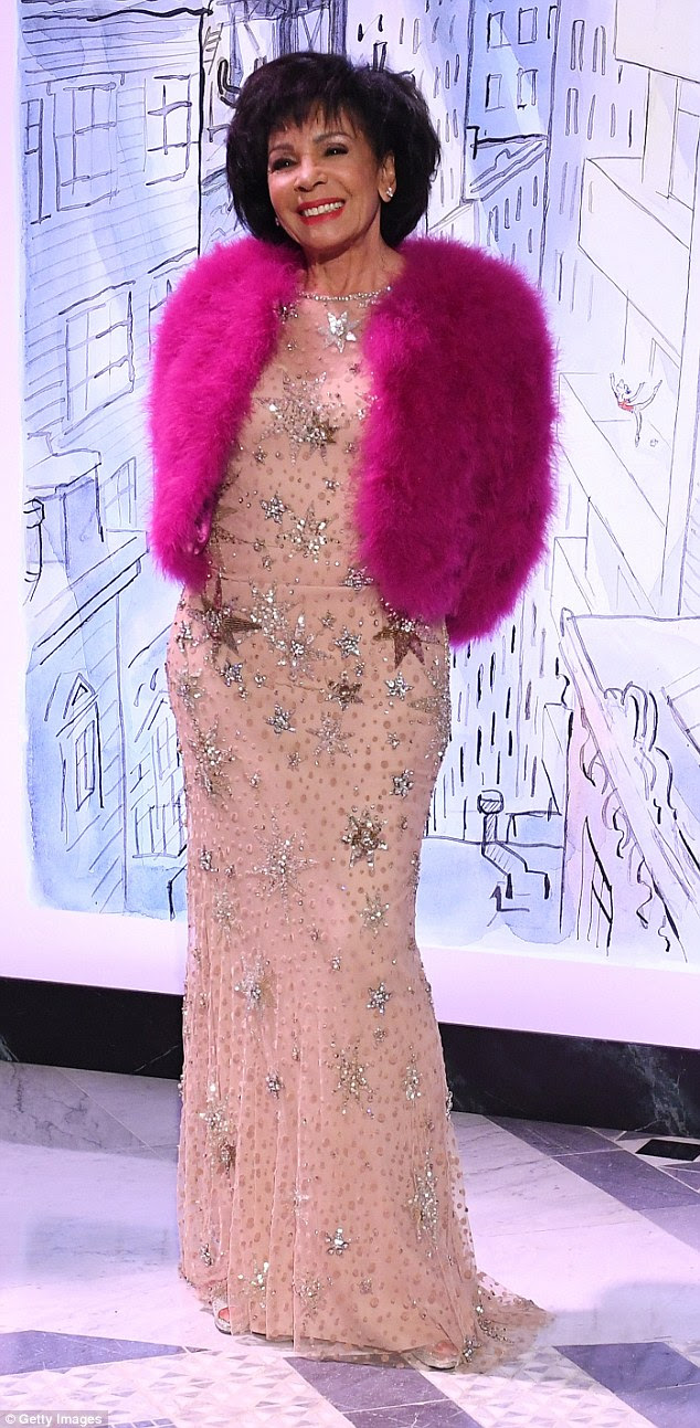 Ageless: Shirley Bassey, 81, also put on an age-defying display as she made an appearance at the ball in an eye-catching fluffy pink jacket