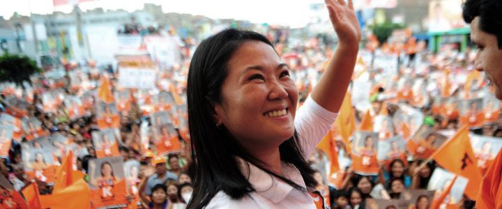 "The presidential candidate for the ""Fuerza 2011"" party, Keiko Fujimori, greets her supporters before delivering a speach in Lima, on March 25, 2011 during her electoral campaign towards the April 10 general election. Polls ahead of next month's presidential vote show that former president (2001-2006) Alejandro Toledo is leading the field with 19,4, from the Nationalist Party Ollanta Humala with 17,6 Pedro Pablo Kuczynski with 17,5 and Keiko Fujimori, the daughter of jailed former president Alberto Fujimori, with 16,1 to the presidency. AFP PHOTO/ERNESTO BENAVIDES PERU-CAMPAIGN-FUJIMORI PERU-CAMPAIGN-FUJIMORI"