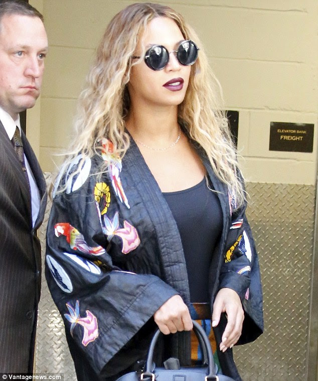 Looking good: The singer sported red lipstick and wavy tresses for her daytime outing