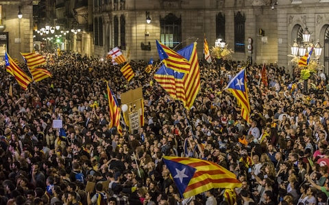 Pro-independence supporters celebrate following the parliamentary vote