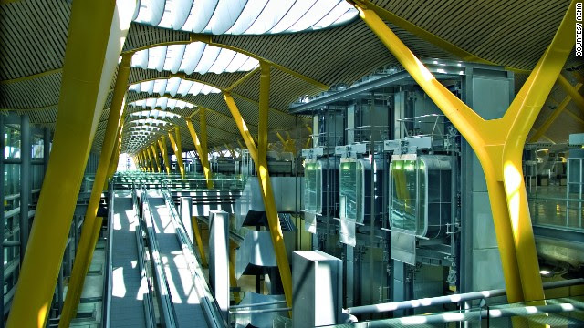 Light comes through large skylights into the circulation systems at Madrid-Barajas Airport's check-in and departures area.