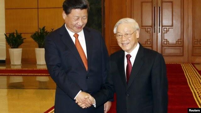 Chủ tịch Trung Quốc Tập Cận Bình và Tổng bí thư Nguyễn Phú Trọng trong một cuộc gặp ở Hà Nội hôm 5/11/2015.