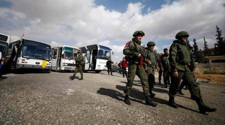 Russian military says helps evacuate 13 civilians from Syria'sGhouta
