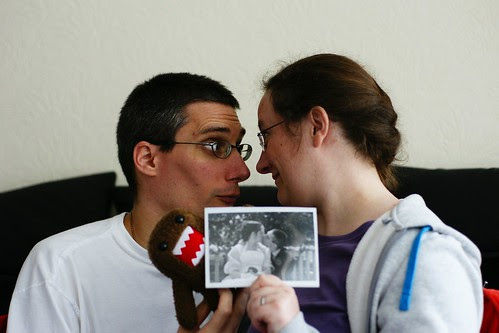 me and Evilstevie looking at each other, holding between us a black and white photograph of us kissing on our wedding day