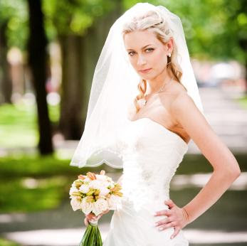 Half up half down wedding hairstyles veil tiara