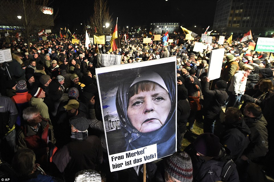http://i.dailymail.co.uk/i/pix/2015/01/13/24A5543D00000578-2908625-Revolt_One_placard_depicted_German_Chancellor_Angela_Merkel_who_-a-6_1421176710146.jpg