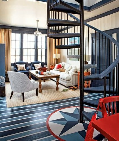 Nautical living room. Navy blue floors with compass rose and touches of red.
