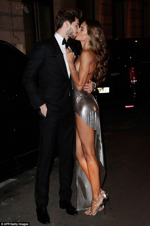 Loved-up: The attractive pair shared a romantic smooch as they arrived to their friend's glitzy birthday bash