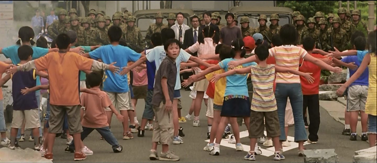 Kids forming a blockade between Gamera and the military.