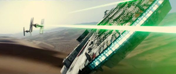 The Millennium Falcon does fancy aerial moves as she confronts two TIE Fighters in STAR WARS: THE FORCE AWAKENS.