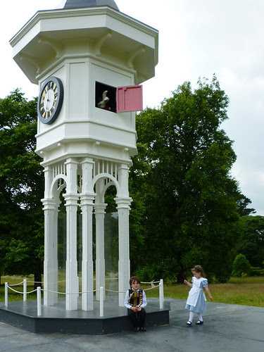 Alice and the white rabbit at the clock-tower