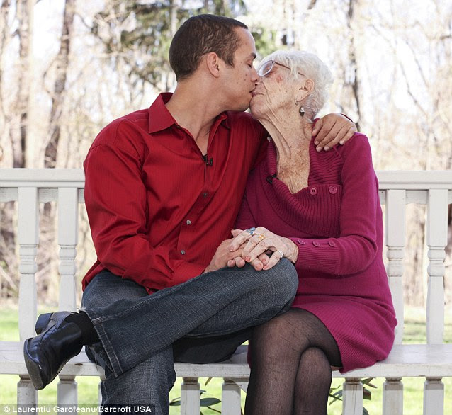Kyle Jones, 31, says he has never dated a woman his own age, shares a tender kiss with Marjorie McCool, 91 at a local park