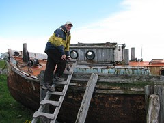 Peter examines the old English yacht