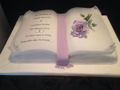 Open Book Wedding Cake with lilac sugar rose . Created in