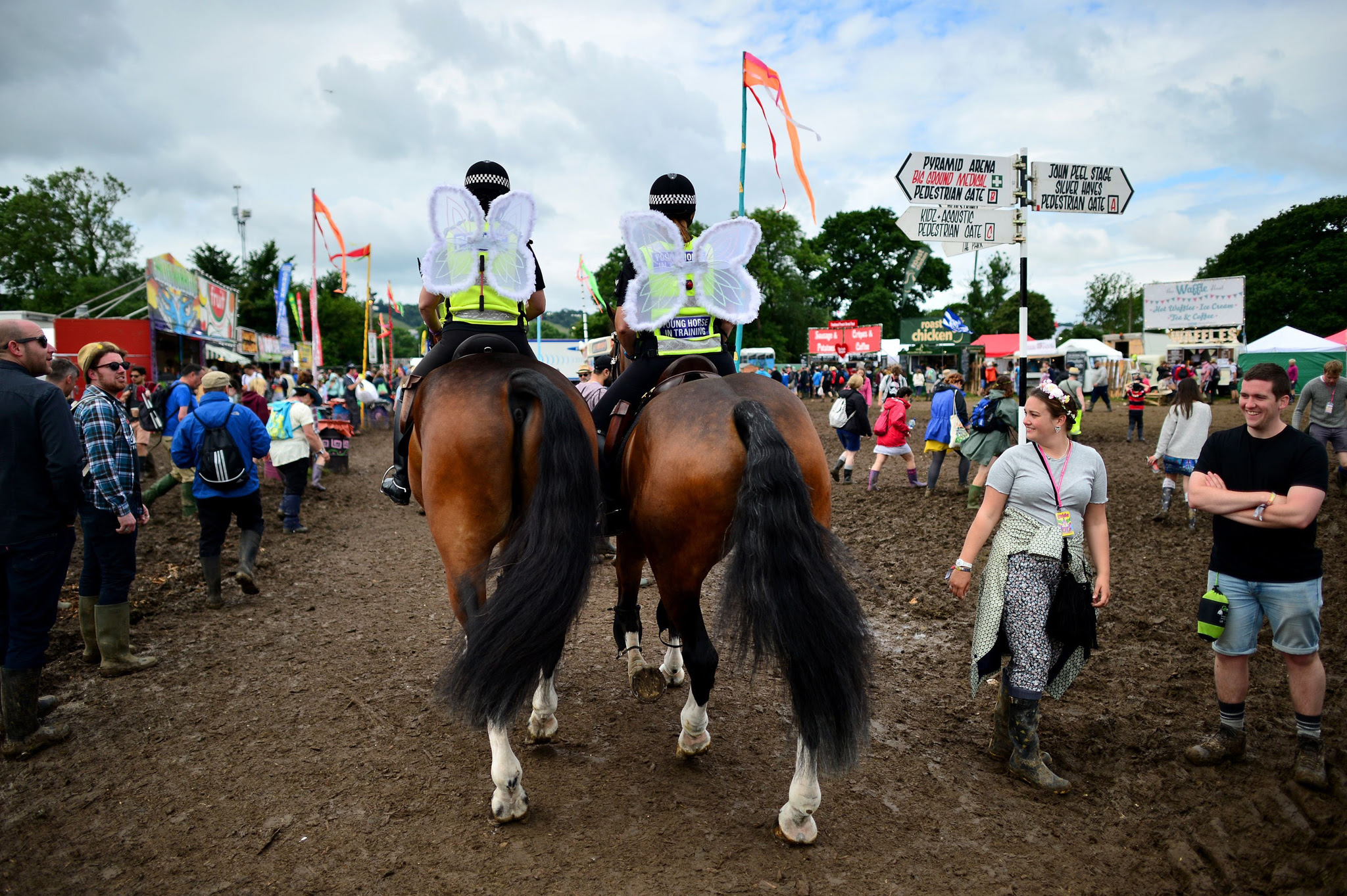Police officers on horseback wearing angel wings at the Glastonbury Festival, at Worthy Farm in Somerset. PRESS ASSOCIATION Photo. See PA story SHOWBIZ Glastonbury. Picture date: Friday June 24, 2016. Photo credit should read: Ben Birchall/PA Wire