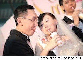 Hong Kong couple sip McDonald's drinks at their McDonald's Wedding
