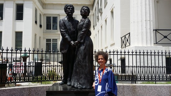 Denise Oliver Velez at the statue of Dred and Harriet Scott in front of the Old Courthouse, in St. Louis Missouri
