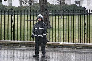 A Uniformed US Secret Service Agent stands gua...