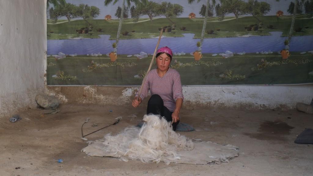 Preparing the wool for felting.