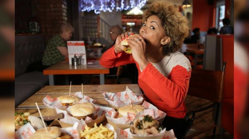 Image result for black woman eating so much