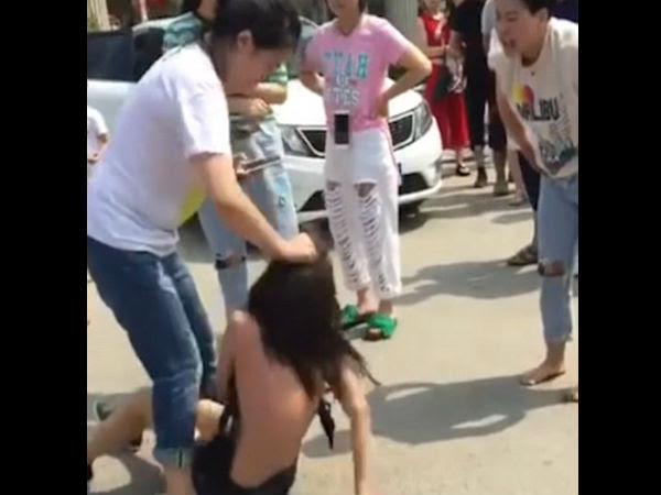 Wife Beats Husband's Alleged Lover And Strips Her Naked on road