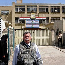 Malcom Phelps stands near the Minister of Education's Teacher Training Center in Baghdad