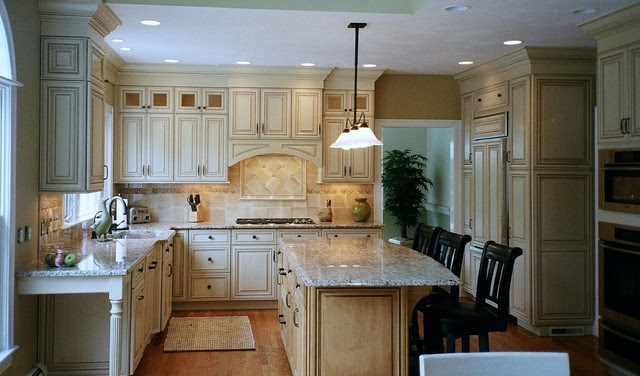 almond glazed door, stacked wall cabinets, arched hearth ...