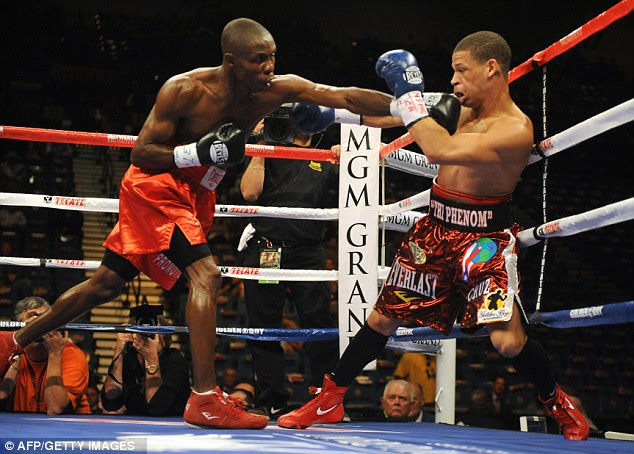 Cornelius Lock (left) of the US knocks down Orlando Cruz of Puerto Rico during his NABO Featherweight title fight at the MGM Grand Garden Arena on September 19, 2009 in Las Vegas