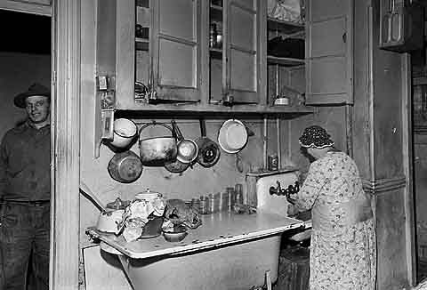 Kitchen of a Lower East Side (East Village) tenement that was torn down to clear a 16 acre site for Wald Houses, November 28, 1945.