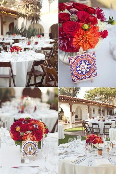 wedding centerpiece floral and mexican spanish tiles. red