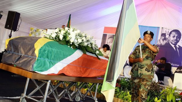 A member of the Umkhnto We Sizwe Military Veterans Association forms a guard of honour around the coffin containing the remains of anti-apartheid and former Drum magazine journalist Nat Nakasa in a marquee at the King Shaka International airport on 19 August 2014  - Durban, South Africa