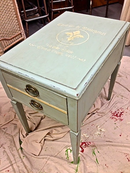 Painted with La Craie (The Chalk) paint in Creme de Menthe w/ stencil and stripe detail in Jolie Blonde. Distressed and waxed with dark brown wax.