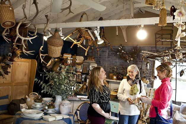 Gwynneth Alldis (left), daughter of Tancredi & Morgen's owners, talks with shoppers Lorene Morgan and Louise Von Hasslen at the boutique in Carmel Valley. Photo: Jason Henry, Special To The Chronicle