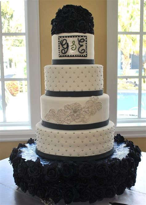 Navy blue, silver and white wedding cake with silver