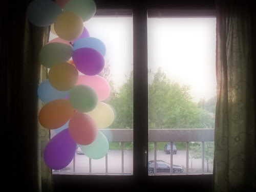window and balloons