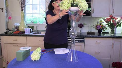 How to Decorate a Tall, Clear Centerpiece Vase : Flower