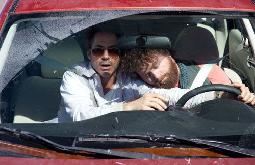 Peter Highman (Robert Downey Jr.) tries to avert disaster as Ethan Tremblay (Zach Galifianakis) snoozes in DUE DATE.