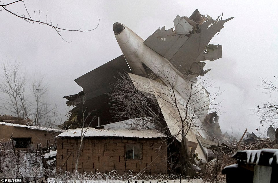 Plane debris is seen at the crash site of a Turkish cargo jet near Kyrgyzstan's Manas airport near Bishkek on January 16. It crashed after unsuccessfully trying to land in fog 15 miles to the north of the country's capital