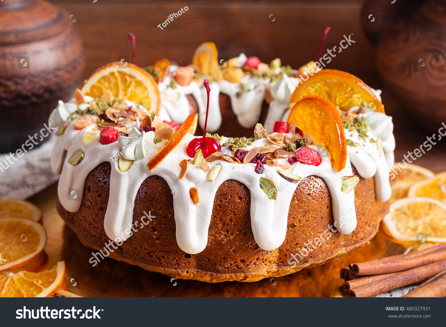 http://www.shutterstock.com/pic-480327931/stock-photo-traditional-bundt-cake-decorated-with-white-sugar-icing-and-fruit-on-rustic-wooden-background.html