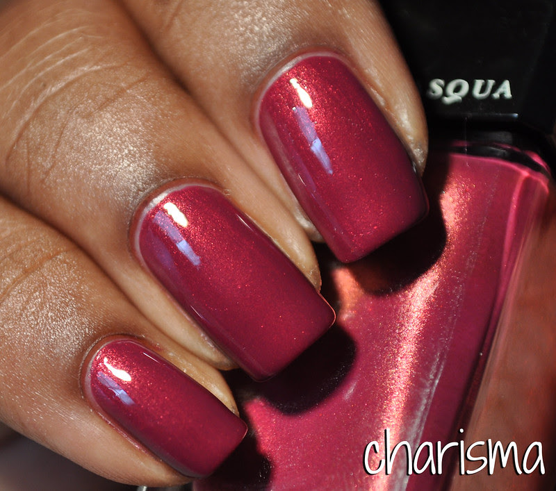 raspberry pink red with gold shimmer nail polish