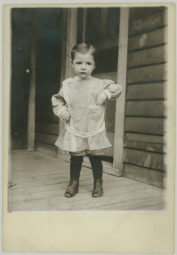 Boy in playclothes