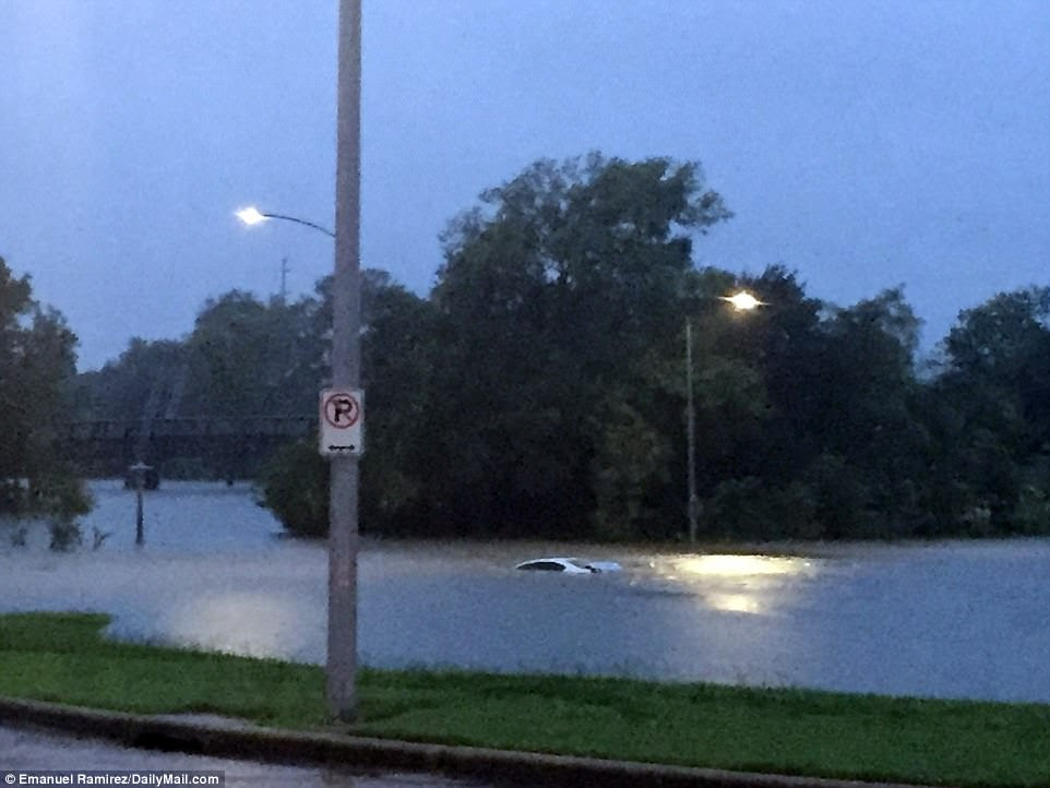 An abandoned BMW lies on the Waugh street bridge over Buffalo Bayou near downtown Houston on Tuesday
