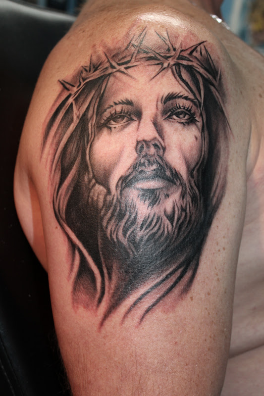 Grey Ink Jesus Portrait Tattoo On Right Shoulder