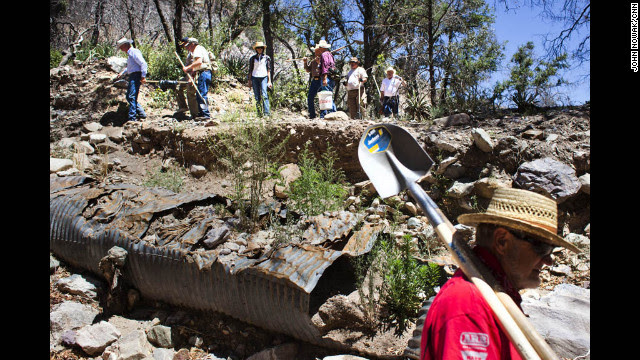 Volunteers make their way through the Coronado National Forest to Gardner Spring, one of the sources of water for the city of Tombstone.