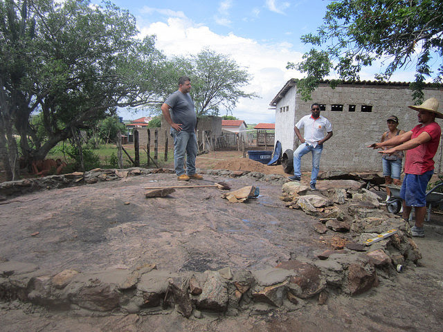 This concrete tank is being built on a large rock on the farm of Normaleide de Oliveira, in the municipality of Pintadas, to be used for fish farming. Stones were used to make the walls using cement, on top of a rock in order to facilitate irrigation by gravity, in an example of agricultural development that optimises the use of the scarce water in the Sertão eco-region in Northeastern Brazil. Credit: Mario Osava / IPS