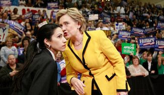 """Huma Abedin, who has been at Hillary Rodham Clinton's side as her personal assistant or """"body woman"""" since the 2008 presidential race, faced criticism for standing by her husband, former Rep. Anthony Weiner, after sexting scandals that damaged his political career. She now has to defend her own actions with the Clinton Foundation and the State Department email scandal. (Associated Press) ** FILE **"""