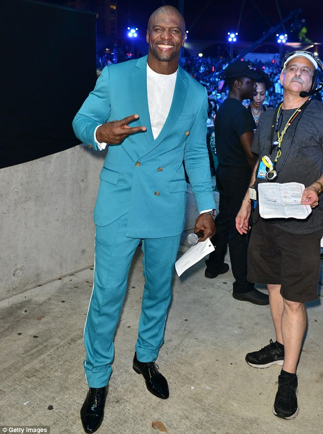 Peace out: Terry Crews looked dapper in a marine blue suit