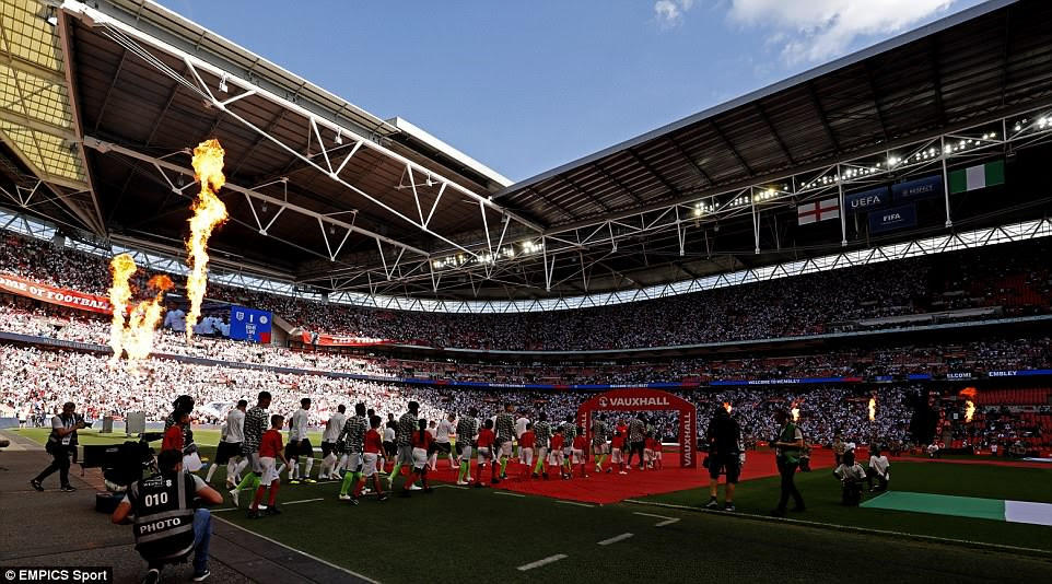 England and Nigeria walk out to a packed Wembley Stadium before kick-off of their World Cup warm-up match