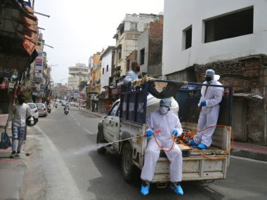 Indian municipal workers spray disinfectants in Jammu. AP