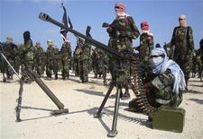 Members of the hardline al Shabaab Islamist rebel group parade their weapons in Somalia's capital Mogadishu, January 1, 2010.  REUTERS/Feisal Omar